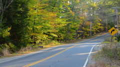 Waterford Maine fall colors road with cars driving in fall foliage color in - stock footage