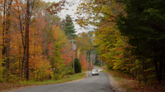 Stock Video Footage of Bethel Maine fall colors road with cars driving in fall foliage color in