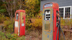 Bethel Maine foliage old ancient gas pumps in fall leaves  in Northern New Stock Footage