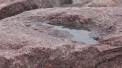 Water on the surface of the granite Stock Footage