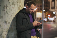 Man standing alone on the street and using cellphone Stock Footage