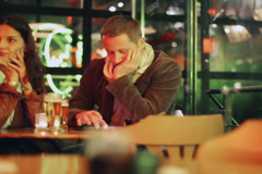 Bored couple sitting in pub at night, steadycam shot Stock Footage