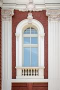 A vertical window with columns. Architectural detail of the Nati Stock Photos