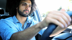 Handsome man driving car feeling lonely and sad Stock Footage