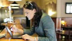 Businesswoman working on laptop computer by counter in bar HD Stock Footage