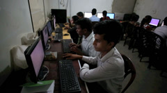 Students learning computer skills in classroom Stock Footage