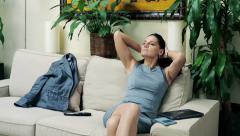 Young businesswoman relaxing on sofa after work at home HD Stock Footage