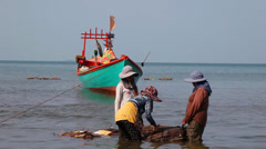 Women overload caught crabs. - stock footage