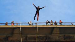 Man does somersaults in a jump from the bridge Stock Footage
