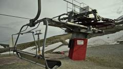 Chair lift empty chairs, seat turning on cableway line, funicular, red block Stock Footage