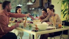 Friends looking at funny things on smartphone during dinner HD Stock Footage