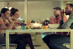 Unhappy, bored friends sitting by the table on bad double date NTSC Stock Footage