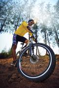 Young man riding mountain bike mtb in jungle track use for sport extreme adve Stock Photos
