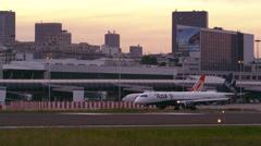 RIO DE JANEIRO, BRAZIL - JUNE 21: Static shot as plane taxis on tarmac as - stock footage