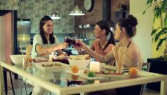 Young girlfriends raising toast, having fun at home party HD Stock Footage