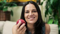 Happy woman eating tasty apple at home HD - stock footage