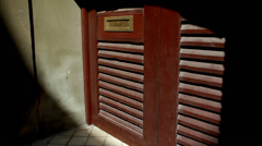 Ray of light moving along a wooden door Stock Footage