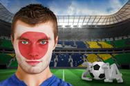 Stock Illustration of Composite image of serious young japan fan with face paint