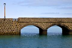 Atlantic ocean lanzarote  bridge   in the blue sky Stock Photos