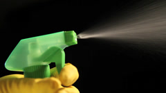 Hand in a rubber glove holding a spray bottle Stock Footage