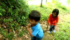 Two Kids Running in The Forest Stock Footage