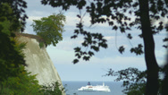 Stock Video Footage of White Cliff With Cruise Ship Passing Rügen Island