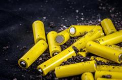Artistic way to represent little yellow batteries Stock Photos