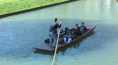 Cambridge punting: close view of single passenger boat and guide Stock Footage