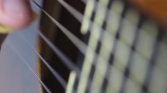 Close-up guitar playing Stock Footage
