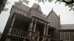 Creepy old house in the rain Stock Footage