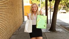 Excited young woman with shopping bags Stock Footage