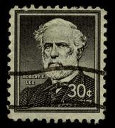 Old postage stamp on a black background. - stock photo