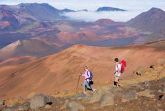 Hikers enjoying walk on amazing mountain trail Stock Photos