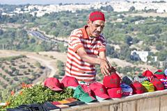 Stock Photo of fes, morocco - october 17, moroccan trader with his handmade merchandise in f
