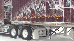 Trucks and tractor trailers stuck on icy highway Stock Footage