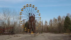 pan from ferris wheel to radioactive playground near chernobyl nuclear accident - stock footage
