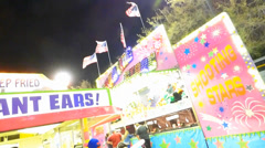 Bright Carnival Midway at Night Stock Footage