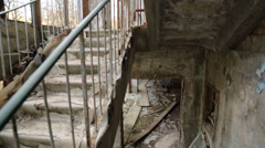 Descent down decaying stairs in radioactive building in pripyat, ukraine, Stock Footage