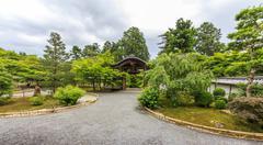 ornamental wooden gate and temple courtyard in arashiyama district, kyoto, ja - stock photo