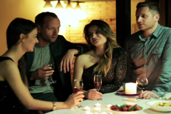 friends talking and drinking wine at the party - stock footage