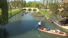 Cambridge punting: boat poles in action near Trinity College bridge - stock footage