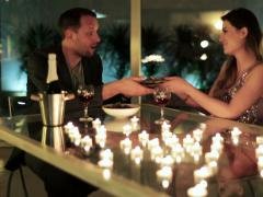 Man receiving a gift from a woman during a romantic meeting Stock Footage