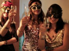 Attractive women in masks making toast and smiling to the camera Stock Footage
