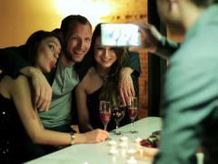 Friends having fun and taking a photo at the party Stock Footage