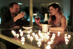 young couple drinking wine and feeding each other with a strawberry - stock footage