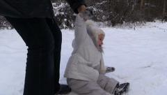 Stock Video Footage of Girl shows artistry and plays the role, sitting on snow. Winter Park.