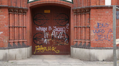 Berlin tags on a church door - Where is Jesus? Stock Footage