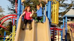 Kids on slide Stock Footage