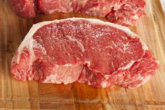organic red raw steak sirloin - stock photo