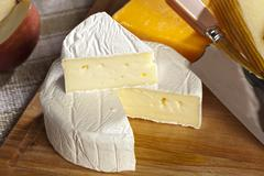 Fresh organic white brie cheese Stock Photos